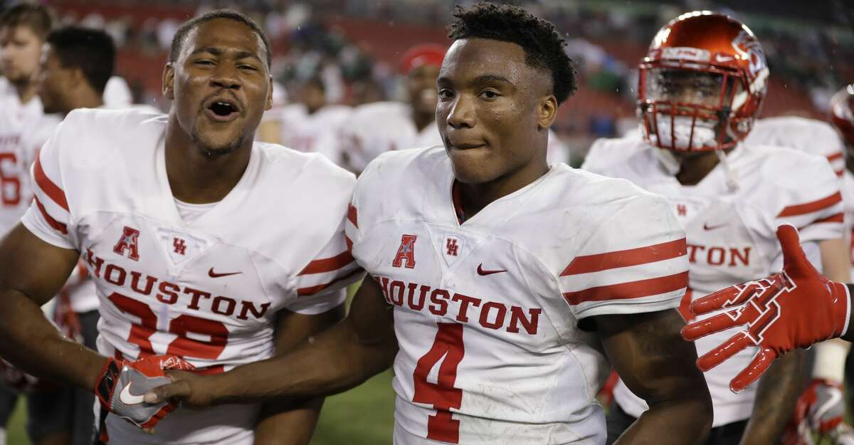 Houston quarterback D'Eriq King (4) celebrates with running back Kevrin Justice (32) during the second half of an NCAA college football game Saturday, Oct. 28, 2017, in Tampa, Fla. Houston upset South Florida 28-24. (AP Photo/Chris O'Meara)