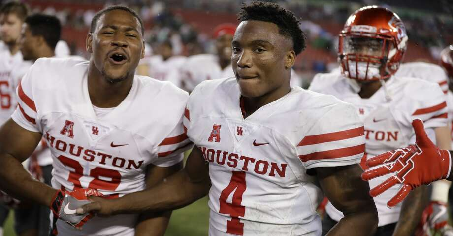 Houston quarterback D'Eriq King (4) celebrates with running back Kevrin Justice (32) during the second half of an NCAA college football game Saturday, Oct. 28, 2017, in Tampa, Fla. Houston upset South Florida 28-24. (AP Photo/Chris O'Meara) Photo: Chris O'Meara/Associated Press