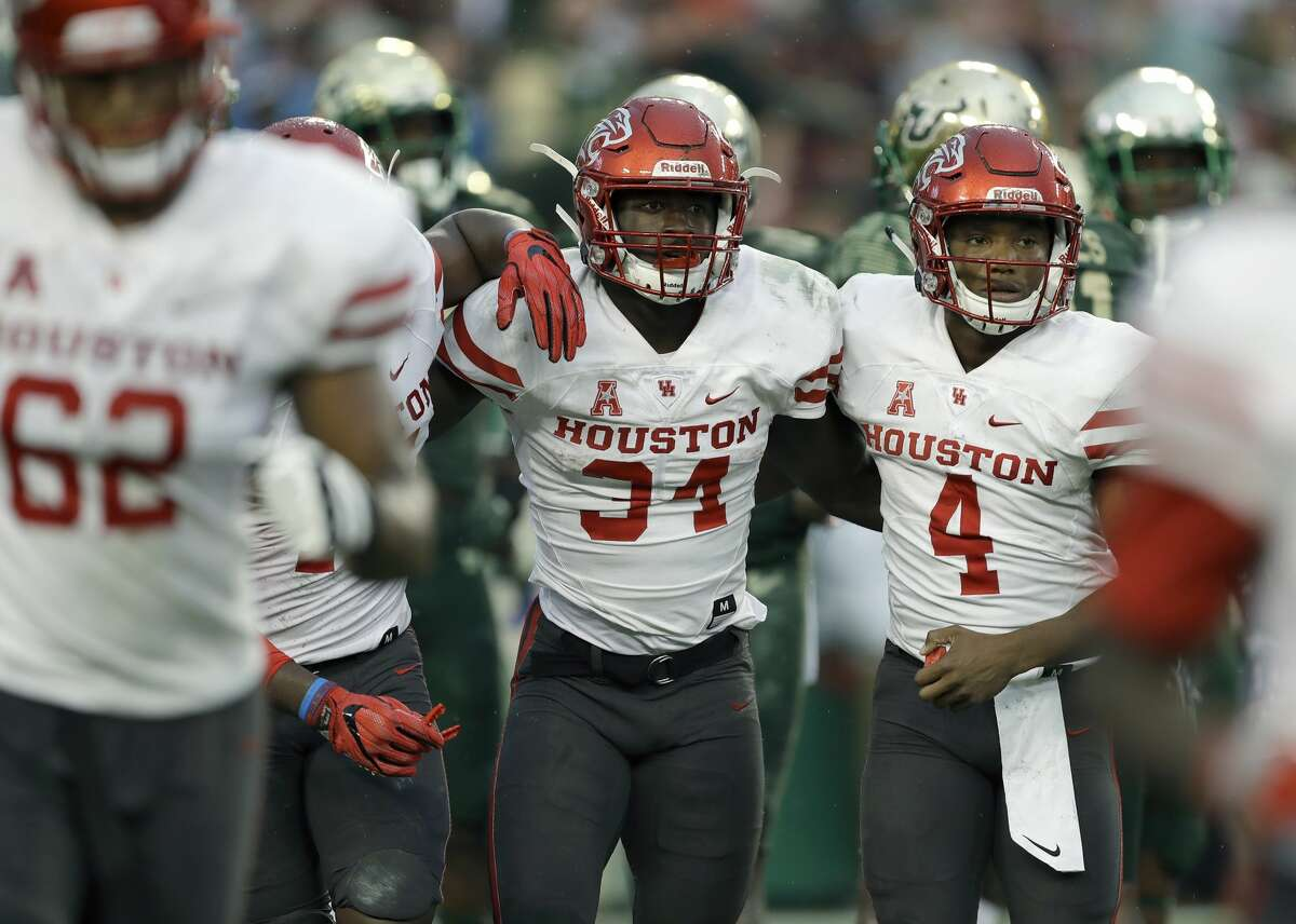 Houston running back Mulbah Car (34) ccelebrates with quarterback D'Eriq King (4) after scoring on a 4-yard touchdown run against South Florida during the second half of an NCAA college football game, Saturday, Oct. 28, 2017, in Tampa, Fla. Houston upset South Florida 28-24. (AP Photo/Chris O'Meara)