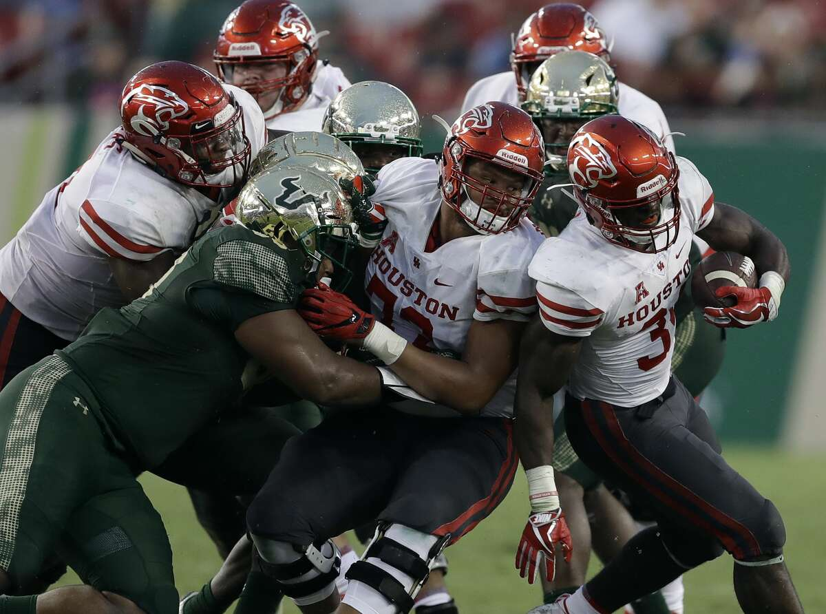 Houston running back Mulbah Car (34) runs against South Florida during the second half of an NCAA college football game Saturday, Oct. 28, 2017, in Tampa, Fla. (AP Photo/Chris O'Meara)