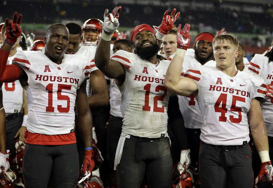Houston players, from left, wide receiver Linell Bonner (15), linebacker D'Juan Hines (12) and linebacker Cameron Doubenmier (45) celebrate after the team defeated South Florida 28-24 during an NCAA college football game, Saturday, Oct. 28, 2017, in Tampa, Fla. (AP Photo/Chris O'Meara) Photo: Chris O'Meara/Associated Press