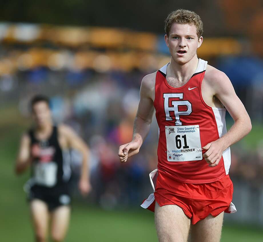 Fairfield Prep senior Drew Thompson captures the first place in 15:40 at the CIAC class LL state cross country championships, Saturday, Oct. 28, 2017, at Wickham Park in Manchester. Photo: Catherine Avalone, Hearst Connecticut Media