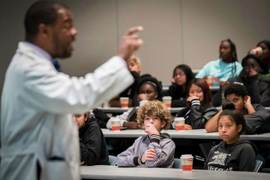 """Yandy Zambrano, center, 13, listens to  a presentation during the """"Mentoring to Medicine"""" program on Saturday. Photo: Marie D. De Jesus, Staff / © 2017 Houston Chronicle"""