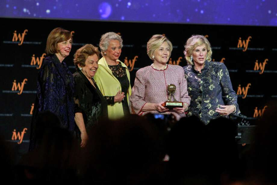 Ann Drake, from left, Donna Shalala, Olga Sanchez Cordero, Hillary Rodham Clinton and Donna De Varona take center stage at the International Women's Conference gala Friday in downtown Houston. Photo: Gary Fountain, For The Chronicle / Copyright 2017 Gary Fountain