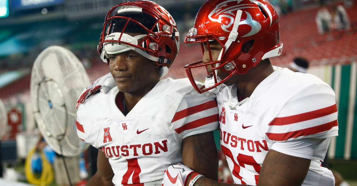 TAMPA, FL - OCTOBER 28: Quarterback D'Eriq King #4 of the Houston Cougars celebrates with wide receiver Kinte Hatton #33 following the Cougars' 28-24 win over the South Florida Bulls at an NCAA football game on October 28, 2017 at Raymond James Stadium in Tampa, Florida. (Photo by Brian Blanco/Getty Images)