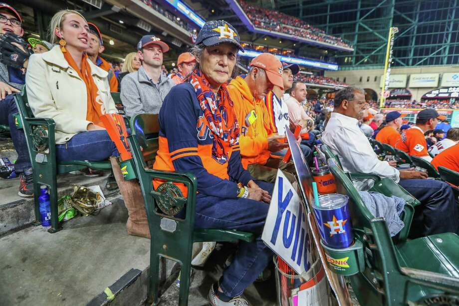 """""""My heart kind of broke a little bit,"""" Barbara Moon said of seeing the image of Gurriel's taunt on social media. """"I'm just hoping that maybe he didn't realize what he was doing, and now maybe he can learn from it."""" Moon said she would not hold up his sign during the rest of the World Series Games. Photo: Steve Gonzales, Houston Chronicle / © 2017 Houston Chronicle"""