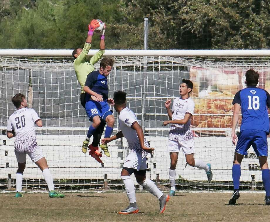 TAMIU's soccer teams play Wednesday in exhibition games with Houston-Victoria. Goalkeeper Carlos Herrera and defender Luis Diaz (2) were both named Preseason All-Heartland Conference Tuesday. Photo: Cuate Santos /Laredo Morning Times File / Laredo Morning Times