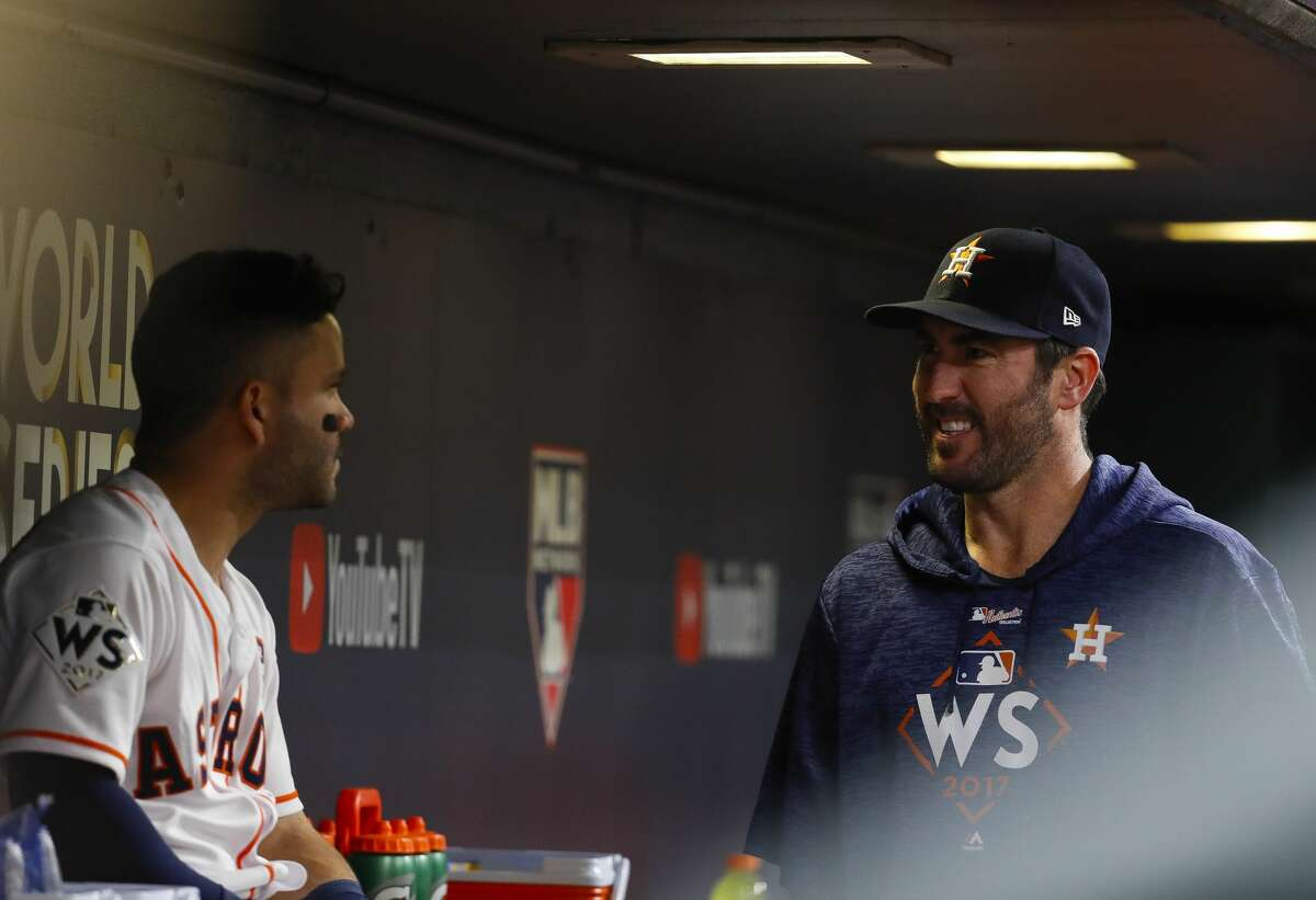 Houston Astros second baseman Jose Altuve (27) talks to Justin Verlander (35) in the dugout during Game 4 of the World Series at Minute Maid Park on Saturday, Oct. 28, 2017, in Houston.