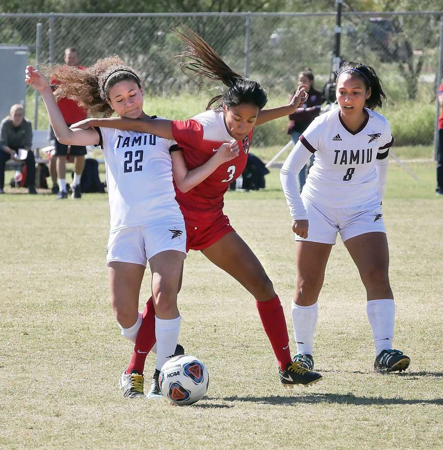 Lady Dustdevil, Valerie Macias looks on as teammate Nicole Cohen and Abigail Olmos, of Dallas Baptist, battle for the ball, Saturday, October 28, 2017 at the TAMIU Soccer Complex. Photo: Cuate Santos /Laredo Morning Times File / Laredo Morning Times