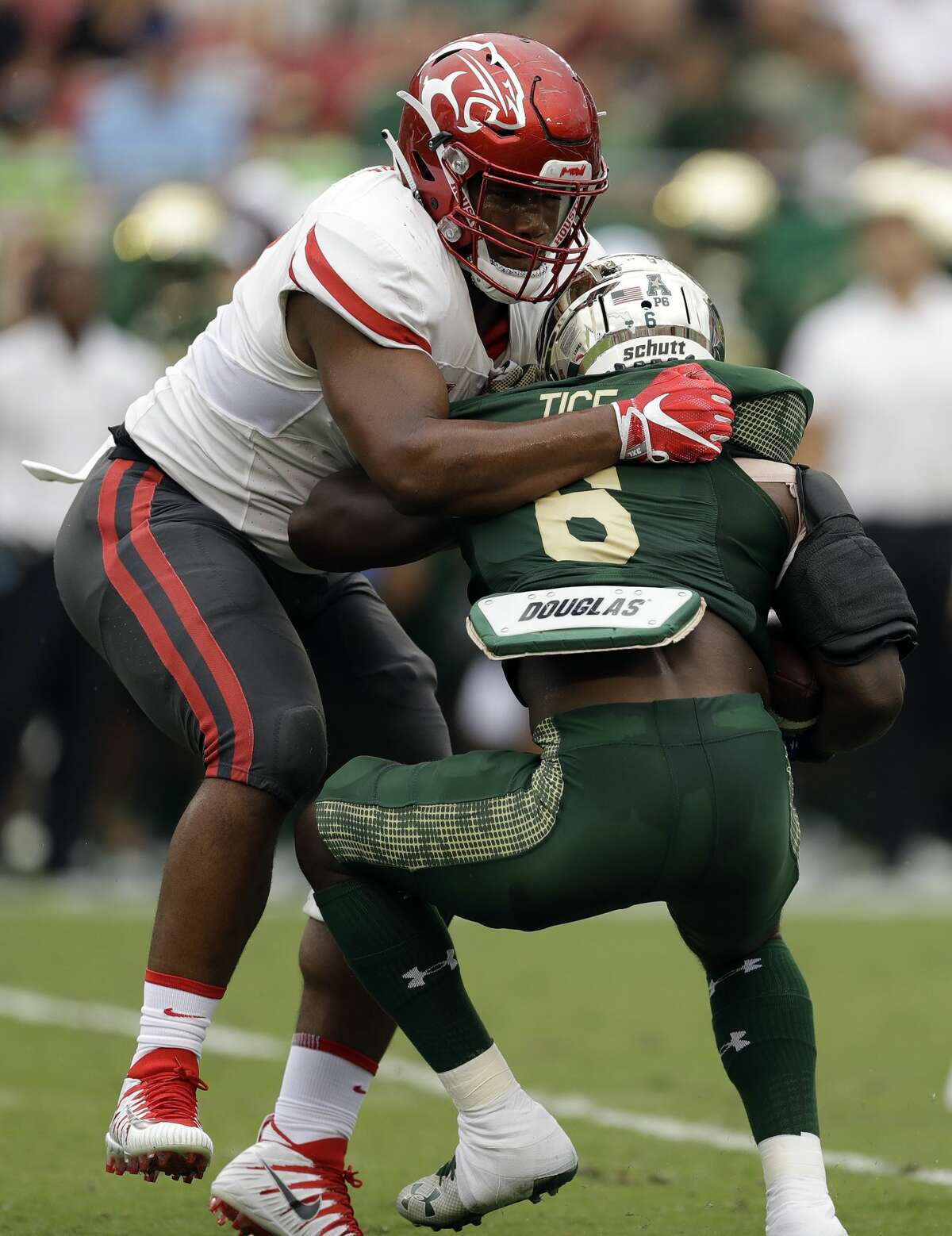 Houston defensive tackle Ed Oliver takes down South Florida running back Darius Tice (6) for a loss during the first half of an NCAA college football game, Saturday, Oct. 28, 2017, in Tampa, Fla. (AP Photo/Chris O'Meara)