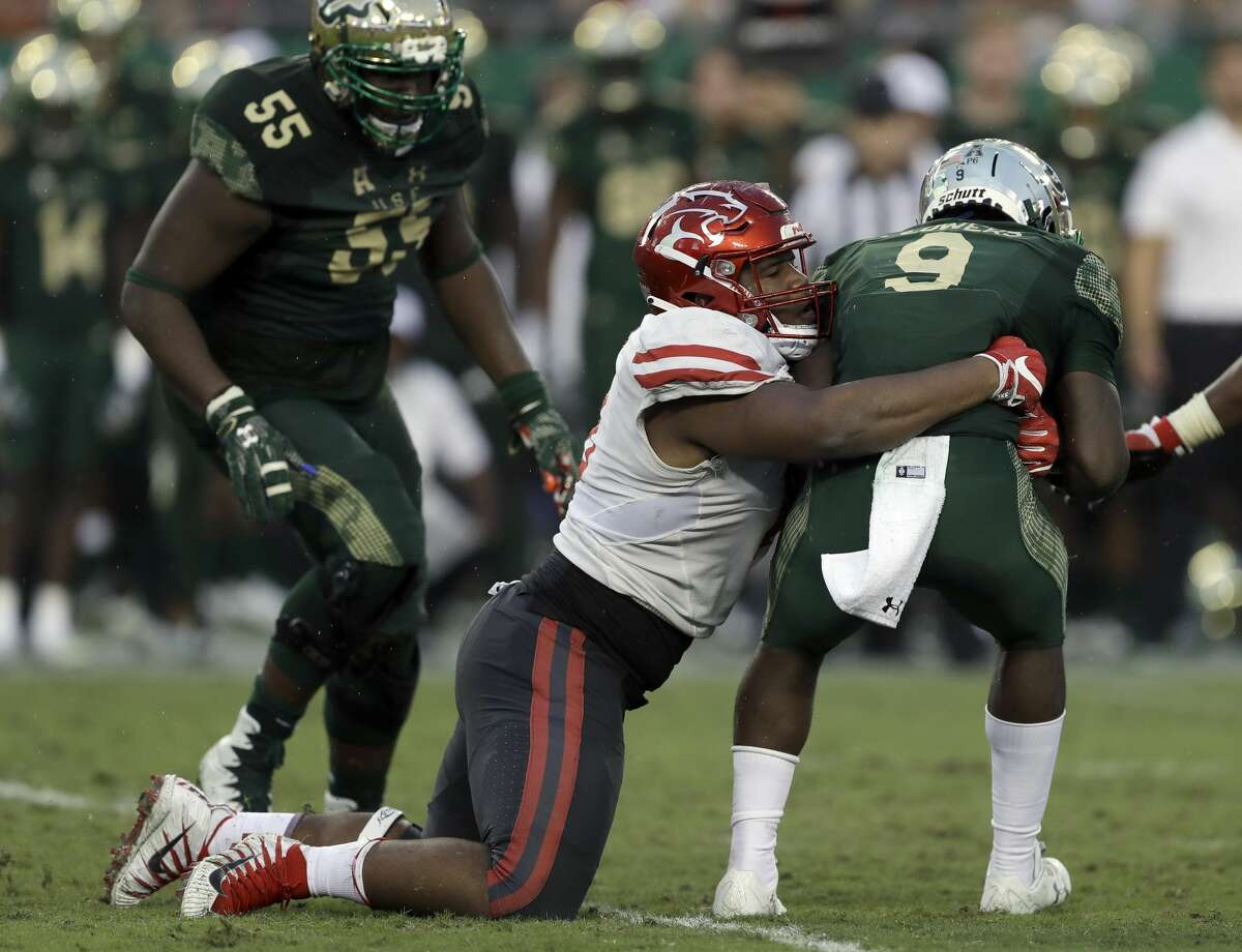 Houston defensive tackle Ed Oliver (10) has been subjected to a large number of low blocks this season and was injured after one of them. On Wednesday, coach Major Applewhite said the NCAA is looking into making those kind of blocks illegal.