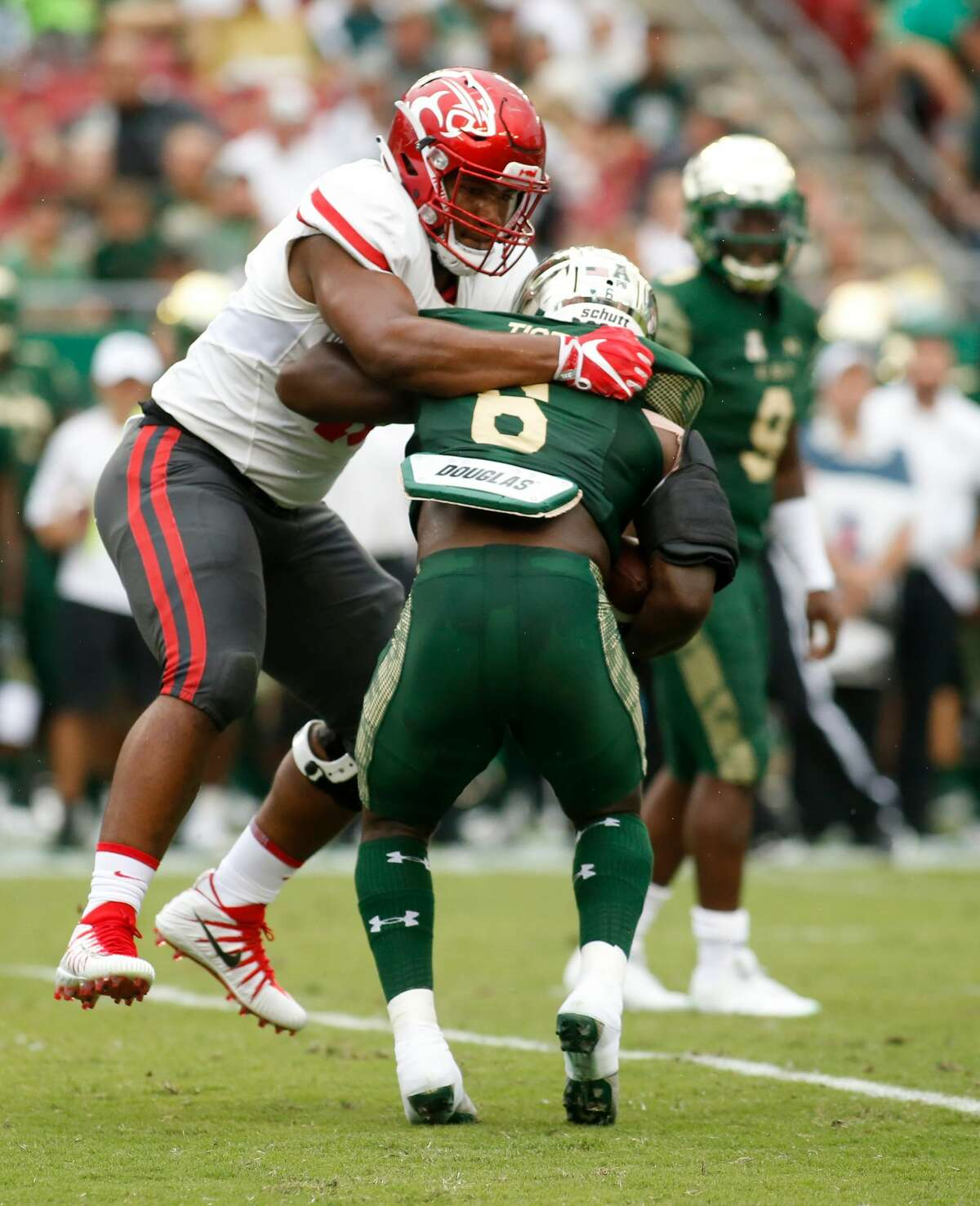 TAMPA, FL - OCTOBER 28: Defensive tackle Ed Oliver #10 of the Houston Cougars tackles running back Darius Tice #6 of the South Florida Bulls during the first quarter of an NCAA football game on October 28, 2017 at Raymond James Stadium in Tampa, Florida. (Photo by Brian Blanco/Getty Images)