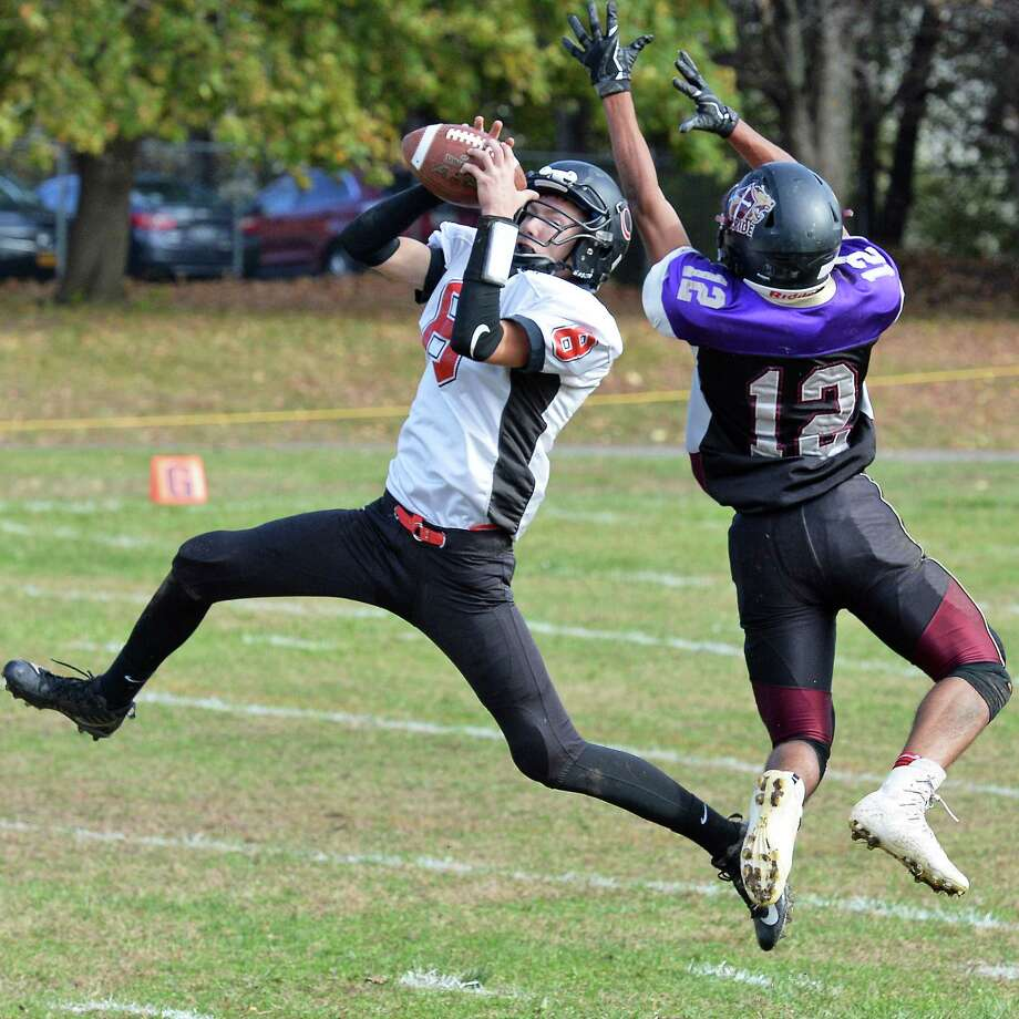 Chatham's #8 Kaleb Taylor, left, intercepts a pass meant for Holy Trinity's #12 Nacier Hundley during their Class C football semifinal Saturday Oct. 28, 2017 in Schenectady, NY. Photo: John Carl D'Annibale / 20041945A