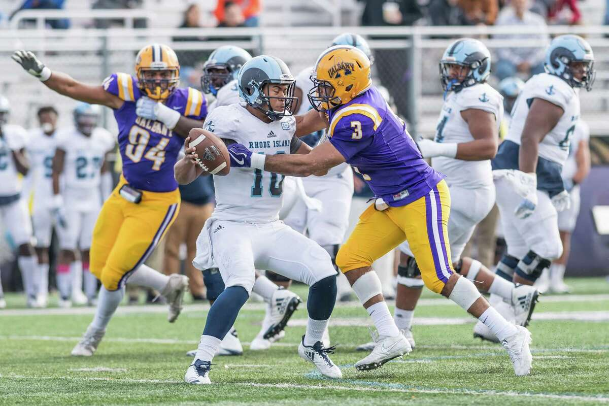 UAlbany linebacker Justin Walker closes in for a sack of Rhode Island quarterback JaJuan Lawson during Rhode Island's 31-14 win over the Danes on Saturday, Oct. 28, 2017, at Casey Stadium. (Bill Ziskin / UAlbany Athletics)