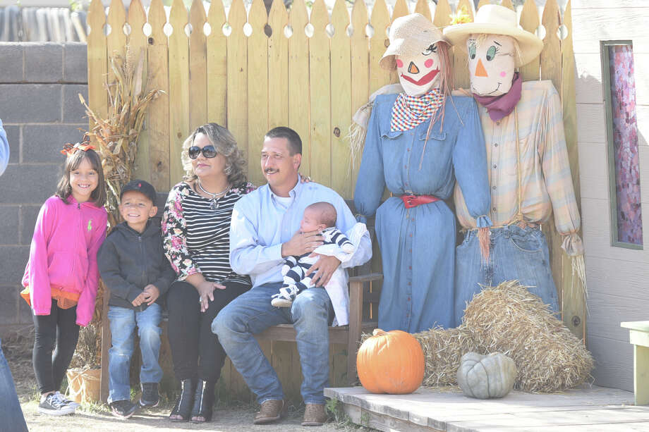 A family poses for a photo in the pumpkin patch at St. Luke's United Methodist Church, Oct. 28, 2017. James Durbin/Reporter-Telegram Photo: James Durbin