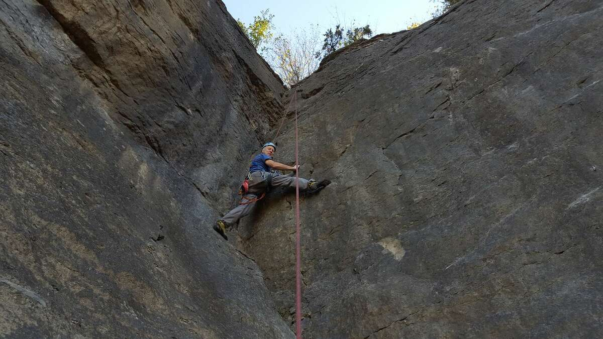 Phil Brown climbs the Crinoid Stem route on the Fossil Wall. credit: Mike Whelen