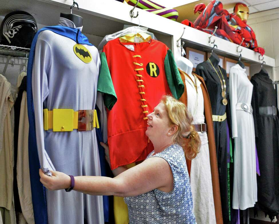 Store manager Tammy Kuren readies superheroes Halloween costume rentals at The Costumer Tuesday Oct. 10, 2017 in Colonie, NY. (John Carl D'Annibale / Times Union)
