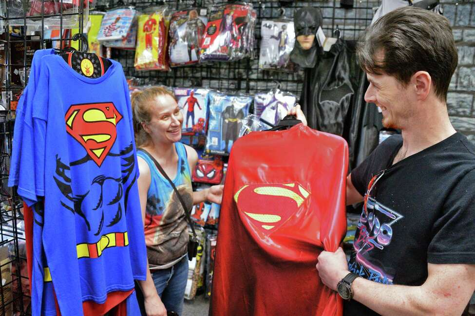 Faith Winne and Josh Evans of Scotia shop for superheroes Halloween costumes at The Costumer Tuesday Oct. 10, 2017 in Colonie, NY. (John Carl D'Annibale / Times Union)