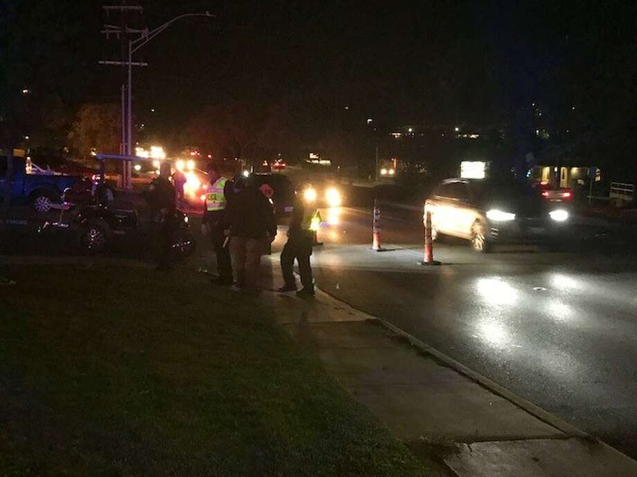 Police say an off-duty Bexar County Constable was struck by a trailer attached to a van on the far North Side Saturday night, Oct. 28., 2017. He was taken to University Hospital in unknown condition. Photo: Alexandro M. Luna