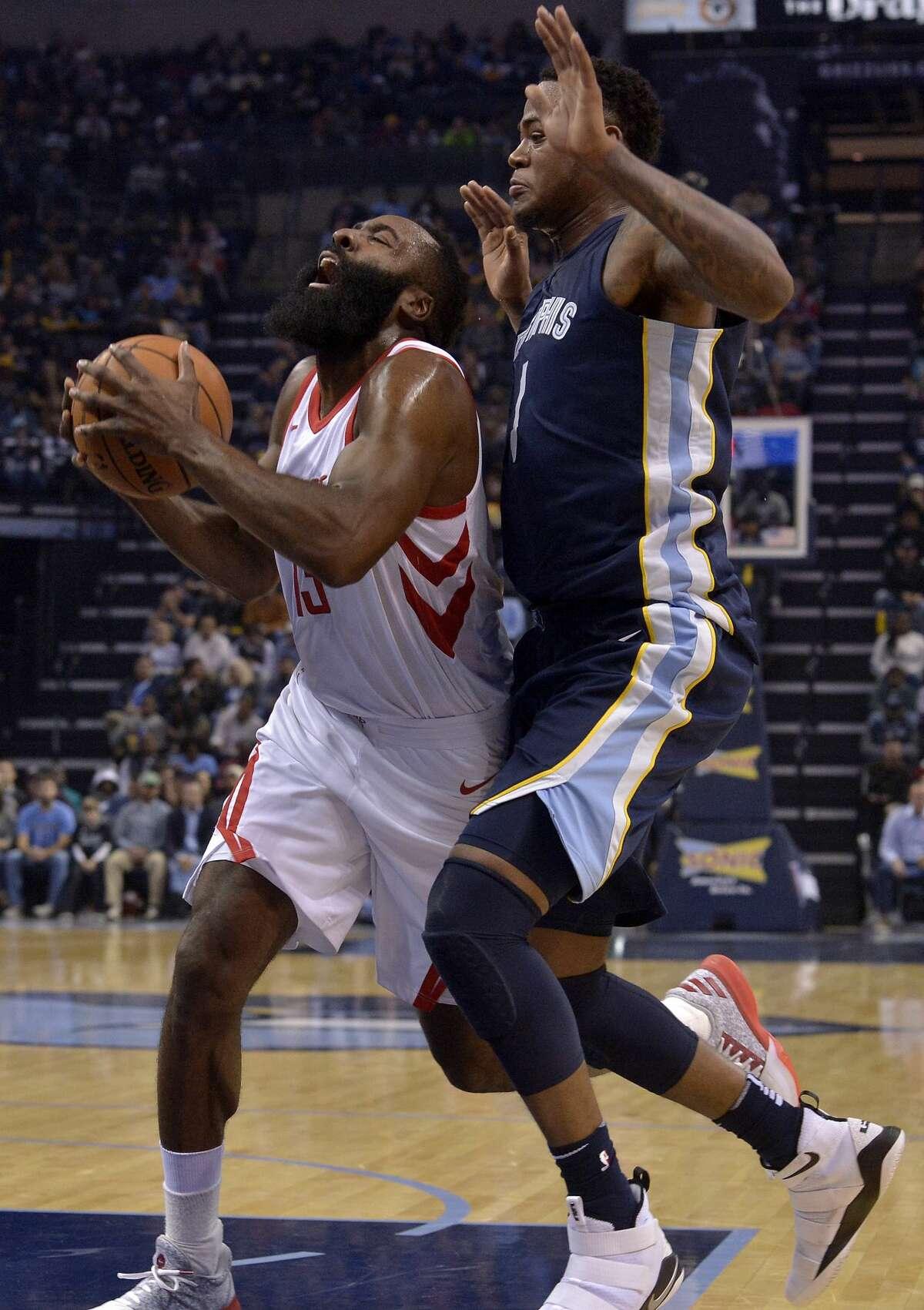 Houston Rockets guard James Harden, left, drives against Memphis Grizzlies forward Jarell Martin (1) in the first half of an NBA basketball game Saturday, Oct. 28, 2017, in Memphis, Tenn. (AP Photo/Brandon Dill)