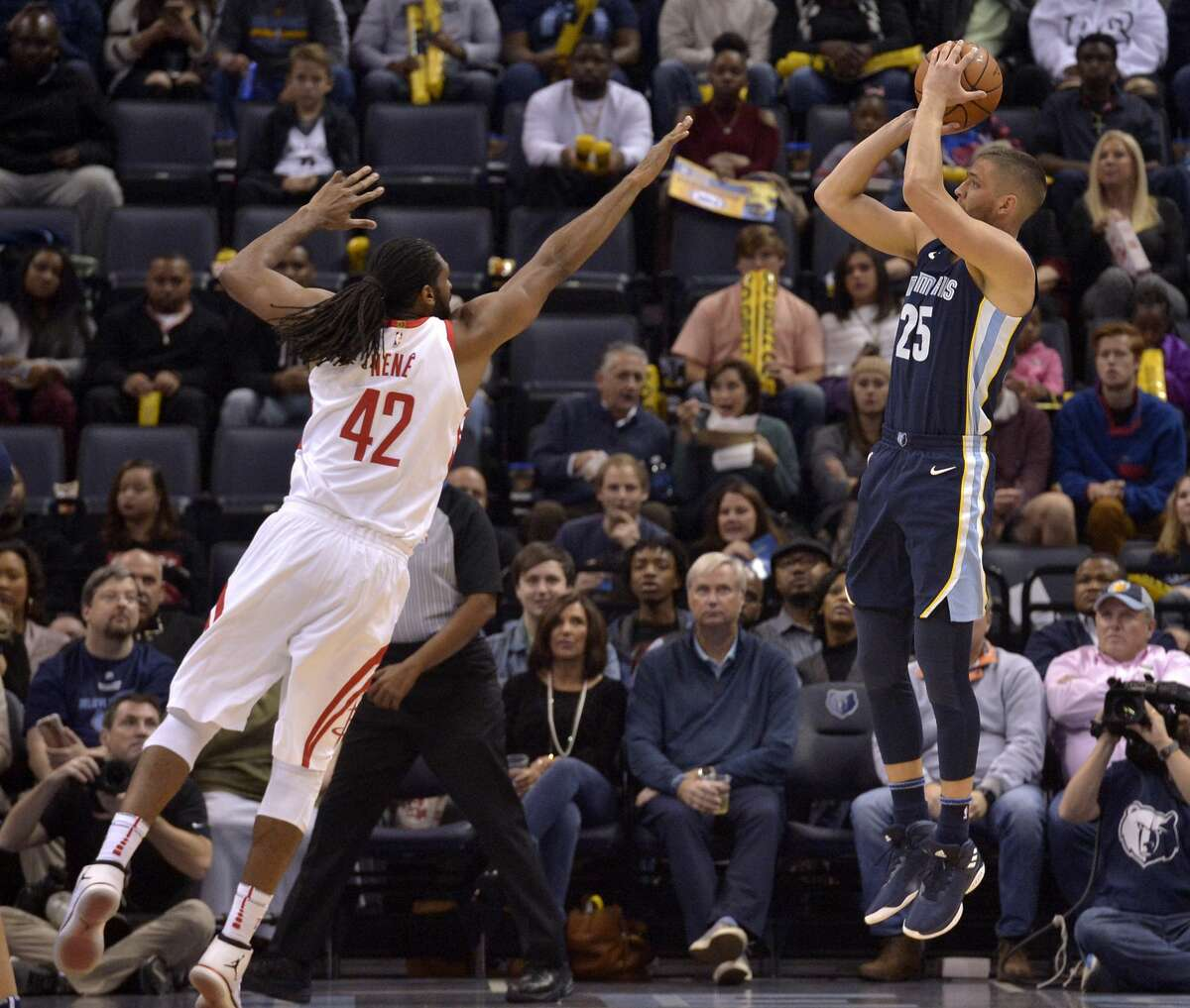 Memphis Grizzlies forward Chandler Parsons (25) makes a three-point shot against Houston Rockets center Nene (42) in the first half of an NBA basketball game Saturday, Oct. 28, 2017, in Memphis, Tenn. (AP Photo/Brandon Dill)