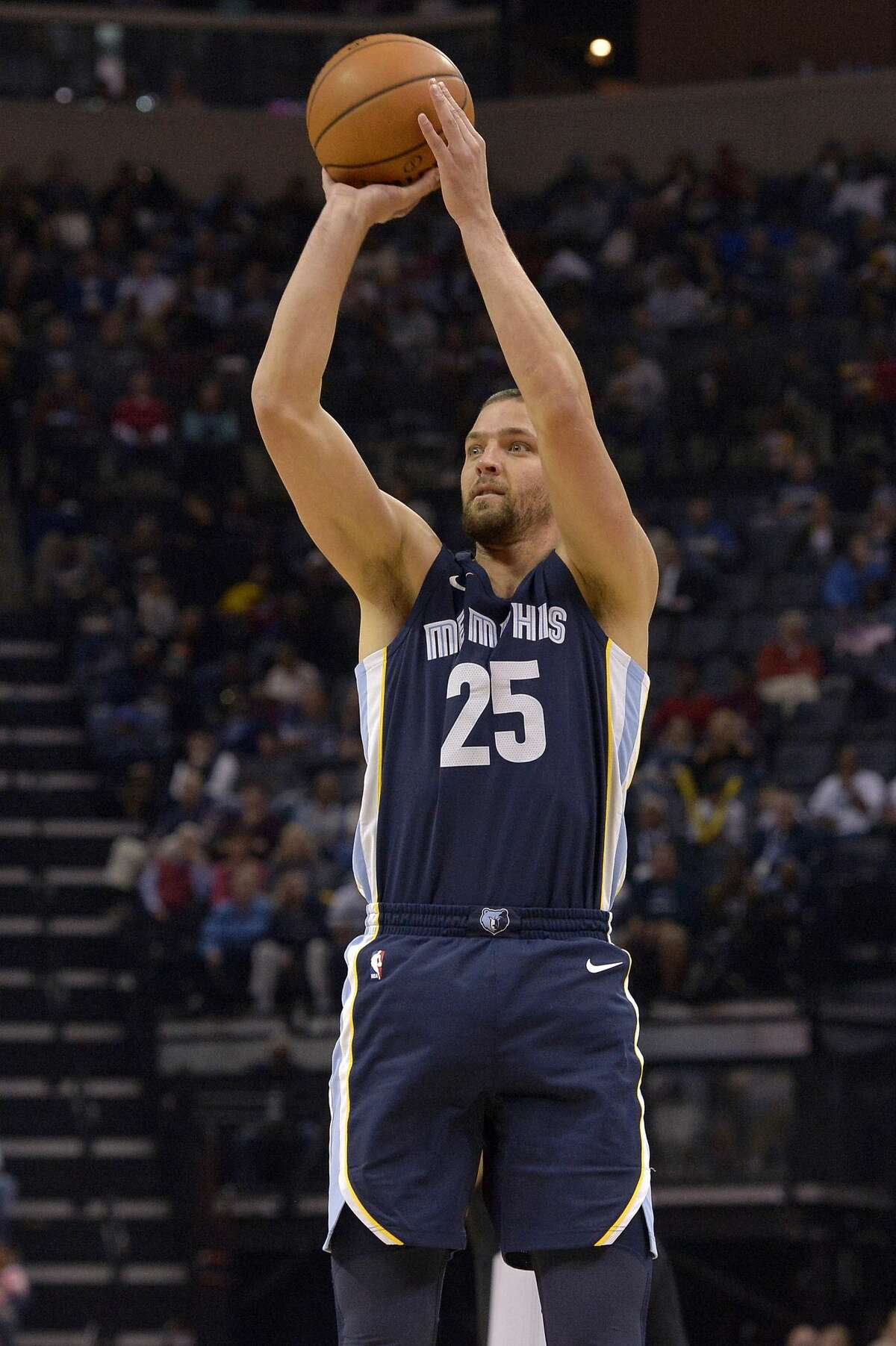 Memphis Grizzlies forward Chandler Parsons (25) takes a three-point shot in the second half of an NBA basketball game Saturday, Oct. 28, 2017, in Memphis, Tenn. (AP Photo/Brandon Dill)