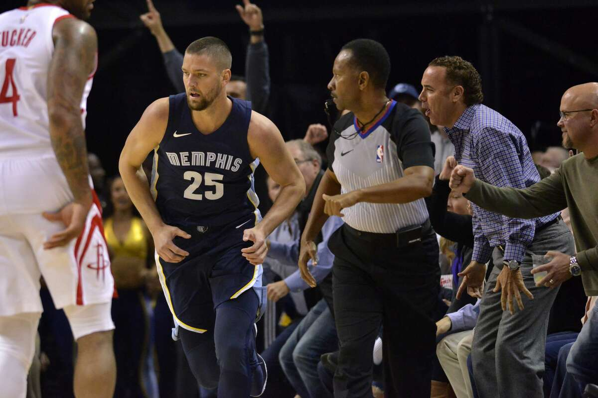Memphis Grizzlies forward Chandler Parsons (25) runs up the court after scoring a three-point shot in the first half of an NBA basketball game against the Houston Rockets Saturday, Oct. 28, 2017, in Memphis, Tenn. (AP Photo/Brandon Dill)