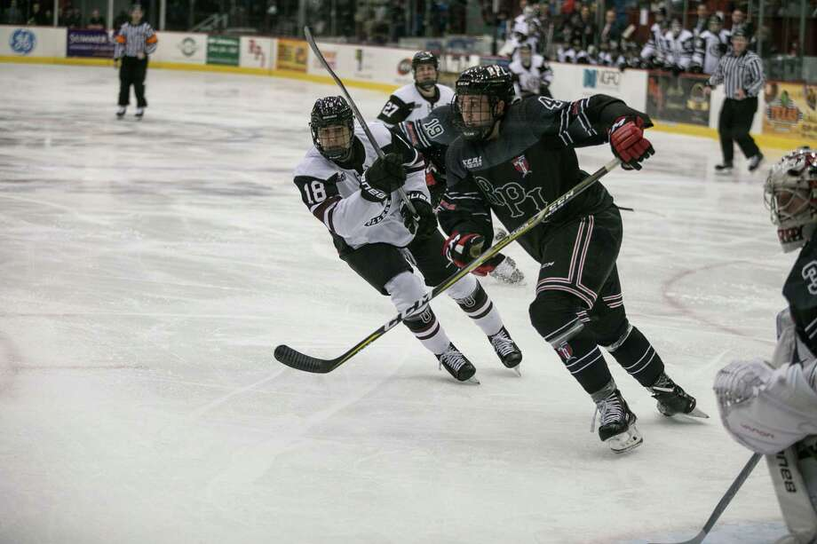 RPI Engineers TommyÊGrant (4) and Union College Dutchmen Brett Supinksi (18) fight for a loose puck at Houston Field House in Troy NY on October 28, 2017. (Photo: Robert Dungan, Special to the Times Union) ORG XMIT: MER2017082023255053 Photo: Robert Dungan / Robert Dungan 2017