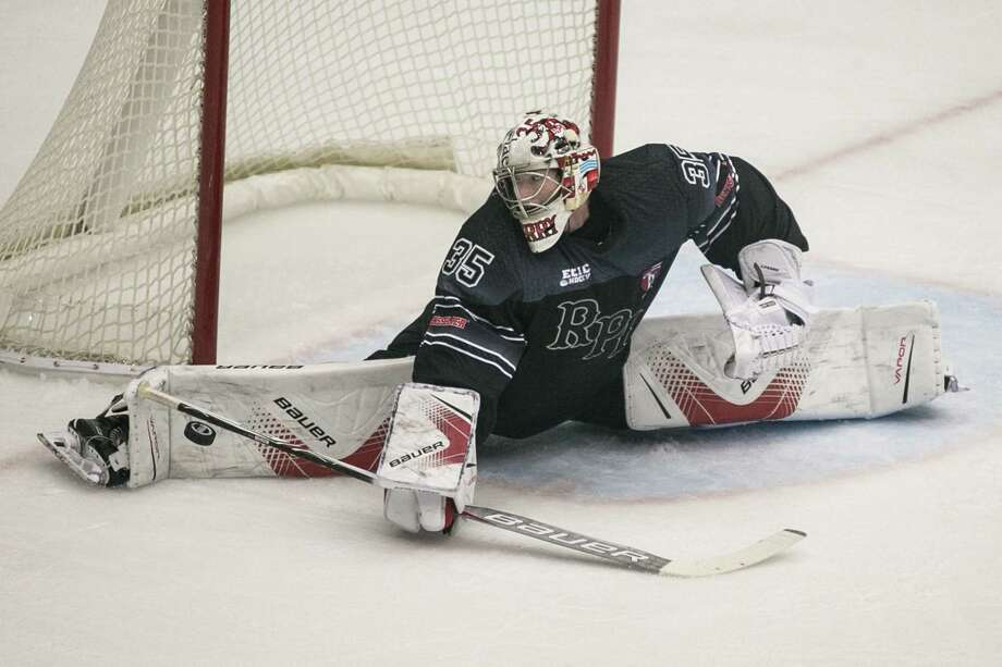 RPI Engineers Goaltender ChaseÊPerry (35) makes a save in the 2nd period against the Union College Dutchmen at Houston Field House in Troy NY on October 28, 2017. (Photo: Robert Dungan, Special to the Times Union) ORG XMIT: MER2017082023255053 Photo: Robert Dungan / Robert Dungan 2017