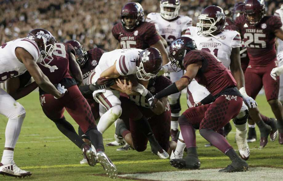 Mississippi State quarterback Nick Fitzgerald refuses to be stopped before crossing the goal line on a 2-yard touchdown run during the first quarter Saturday night. Fitzgerald also passed for two touchdowns in the Bulldogs' victory. Photo: Sam Craft, FRE / AP