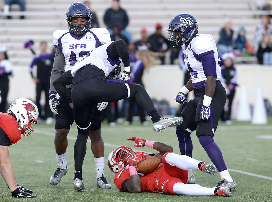 Lamar's Kirkland Banks reacts as Stephen F. Austin's defense celebrate his tackle during their match-up at Lamar Saturday. Photo taken Saturday, October 28, 2017 Kim Brent/The Enterprise Photo: Kim Brent / BEN