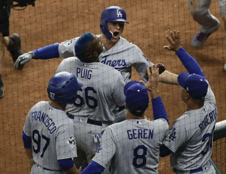 The Dodgers' Joc Pederson is congratulated after hitting a three-run home run in the ninth inning to cement a 6-2 victory over the Astros in Game 4 of the World Series on Saturday. Photo: Eric Gay / Associated Press / Copyright 2017 The Associated Press. All rights reserved.