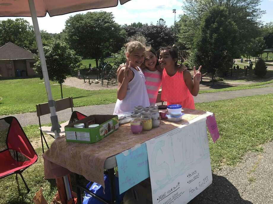 Three girls from Whisconier Middle School created and sold slime to raise money for the Brookfield Library project. Photo: / Contributed Photo