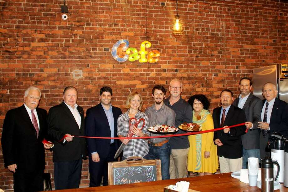 The Cooking Company held a grand opening at 350 Main St. in Middletown Wednesday. From left are Middletown Small Business Development Counselor Paul Dodge, Middlesex County Chamber of Commerce Vice Chairman Jay Polke, Middletown Mayor Dan Drew, Owner Susan Bauer, General Manager Bradford Boulay, Chamber Central Business Bureau Chairman Thomas Byrne, Pamela Steele of the Middletown Downtown Business District, Chamber Chairman Rick Morin, Stone Investment Properties Mike Stone, Chamber President Larry McHugh. Photo: Contributed Photo