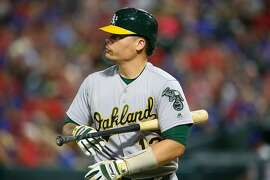 ARLINGTON, TX - SEPTEMBER 30: Bruce Maxwell #13 of the Oakland Athletics reacts after striking out in the sixth inning against the Texas Rangers at Globe Life Park in Arlington on September 30, 2017 in Arlington, Texas. (Photo by Rick Yeatts/Getty Images)