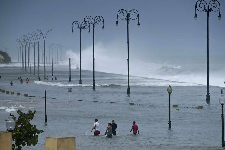 Residents wade through floodwaters on Havana's Malecon on Sept. 10 after the passage of Hurricane Irma. The coastal boulevard was built atop coral reefs and mangrove forests. Photo: Ramon Espinosa, Associated Press