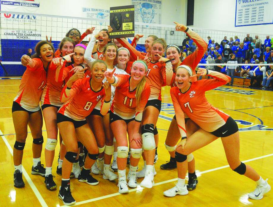 The Edwardsville girls' volleyball team poses with the Class 4A Quincy Regional championship plaque after it defeated the host Blue Devils on Thursday.