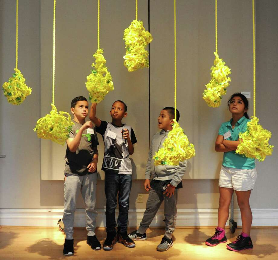 "New Lebanon School fourth-graders, from left, Anthony Goncalves, Bryce Seward, Alexis Sarango, and Fransheska Rojas look at Eve Suter's piece ""Ropes Cloud (1-7)"" as part of the Youth@Art program at the Greenwich Arts Council's Bendheim Gallery in Greenwich, Conn. Wednesday, Oct. 25, 2017. The Bendheim Gallery's exhibition ""Flower Stories"" featuring contemporary artists' perception of flowers in a variety of mediums will run through Nov. 15. Photo: Tyler Sizemore / Hearst Connecticut Media / Greenwich Time"