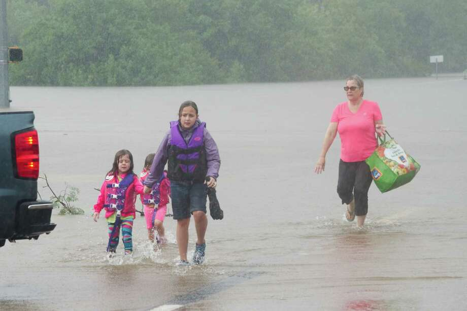 Friendswood residents are evacuated along FM 518 near FM 528 on Aug. 27 after flood waters from Hurricane Harvey swept through the city, destroying 194 homes.  Almost 300 residents were left unemployed by the storm and 71 businesses were damaged, according to a city report. Photo: Kirk Sides / © 2017 Kirk Sides / Houston Chronicle