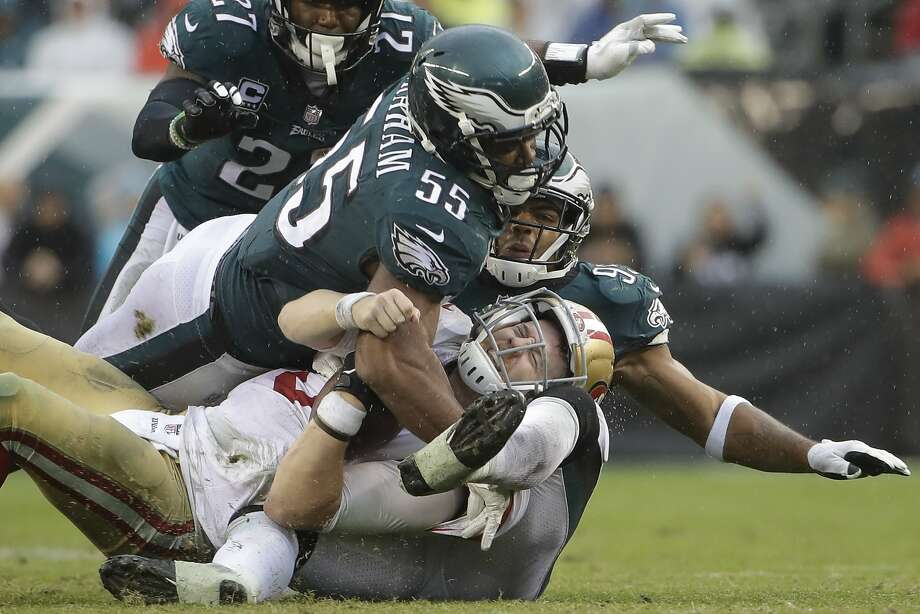 49ers quarterbackC.J. Beathard (bottom) is sacked by the Eagles' Brandon Graham (55) and Mychal Kendricks (right). Photo: Michael Perez, Associated Press