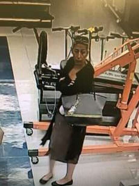 A surveillance image reveals a suspect in the Oct. 20 theft of a pair of white gold earrings from Cash America Pawn, 3726 FM 528. The woman reportedly swapped the earrings with a pair she had in her purse, police said.