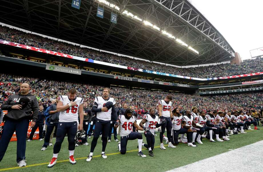 Houston Texans players kneel and stand during the singing of the national anthem before an NFL football game against the Seattle Seahawks, Sunday, Oct. 29, 2017, in Seattle. (AP Photo/Elaine Thompson) Photo: Elaine Thompson, Associated Press / Copyright 2017 The Associated Press. All rights reserved.
