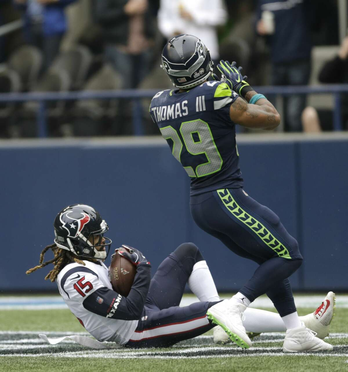 Houston Texans wide receiver Will Fuller (15) comes down with the ball for a touchdown as Seattle Seahawks free safety Earl Thomas (29) looks on in the first half of an NFL football game, Sunday, Oct. 29, 2017, in Seattle. (AP Photo/Stephen Brashear)