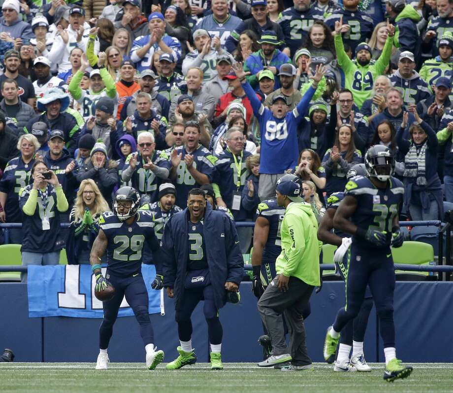 Seattle Seahawks free safety Earl Thomas (29) celebrates with quarterback Russell Wilson (3) after returning an interception 78 yards for a touchdown against the Houston Texans in the first half of an NFL football game, Sunday, Oct. 29, 2017, in Seattle. (AP Photo/Elaine Thompson) Photo: Elaine Thompson/AP