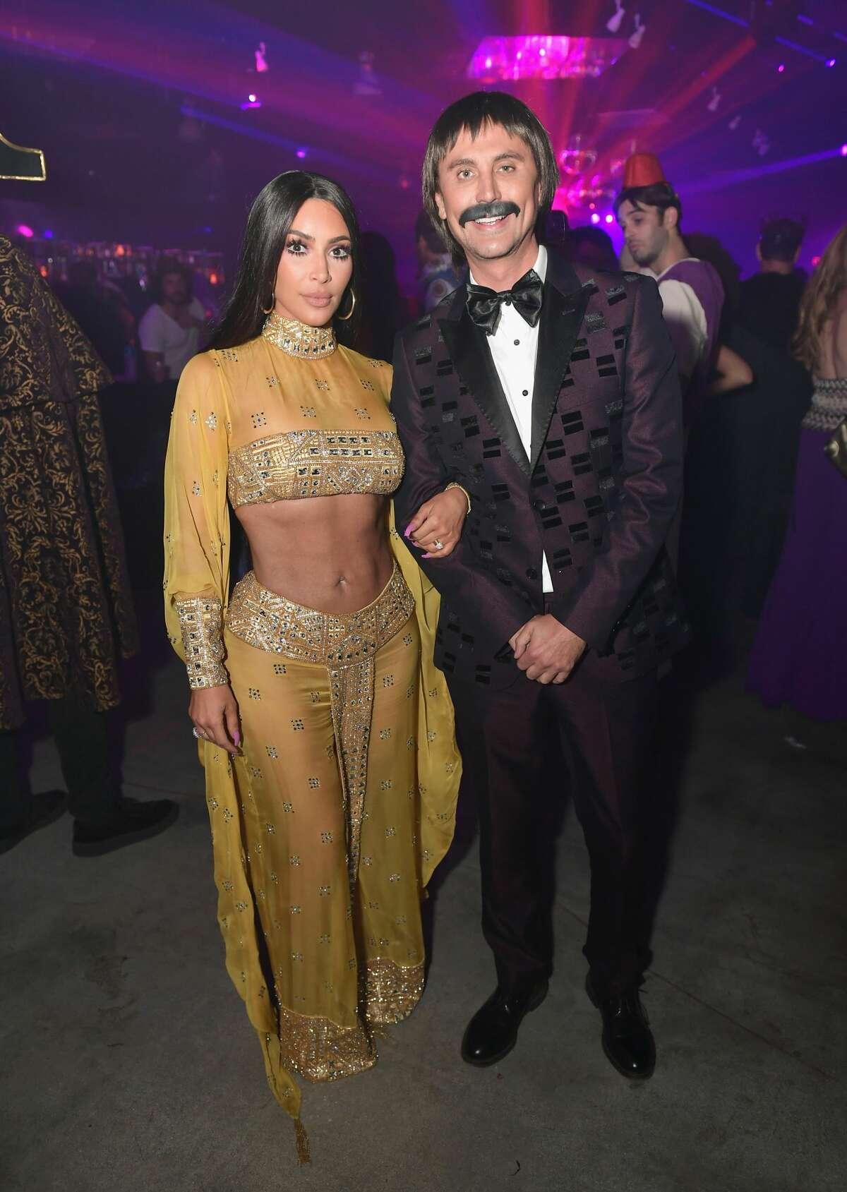 Kim Kardashian (L) and Jonathan Cheban attend Casamigos Halloween Party on October 27, 2017 in Los Angeles, California.