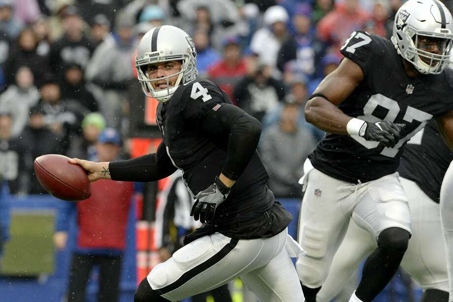 Oakland Raiders quarterback Derek Carr rolls out after faking a handoff during the first half of an NFL football game against the Buffalo Bills, Sunday, Oct. 29, 2017, in Orchard Park, N.J. (AP Photo/Adrian Kraus) Photo: Adrian Kraus, Associated Press