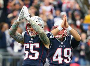 FOXBORO, MA - OCTOBER 29: Cassius Marsh #55 and Trevor Reilly #49 of the New England Patriots signal for a safety during the second quarter of a game against the Los Angeles Chargers at Gillette Stadium on October 29, 2017 in Foxboro, Massachusetts. (Photo by Maddie Meyer/Getty Images)