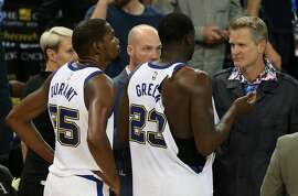 Golden State Warriors coach Steve Kerr talks with Draymond Green (23) following his ejection for a scuffle as Kevin Durant (35) looks on during the Golden State Warriors game versus the Washington Wizards on October 27, 2017 at Oracle Arena in Oakland, California.