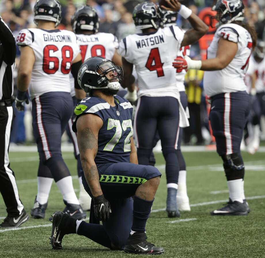 Seattle Seahawks defensive end Michael Bennett (72) kneels after sacking Houston Texans quarterback Deshaun Watson (not shown) in the first half of an NFL football game, Sunday, Oct. 29, 2017, in Seattle. (AP Photo/Elaine Thompson) Photo: Elaine Thompson/AP