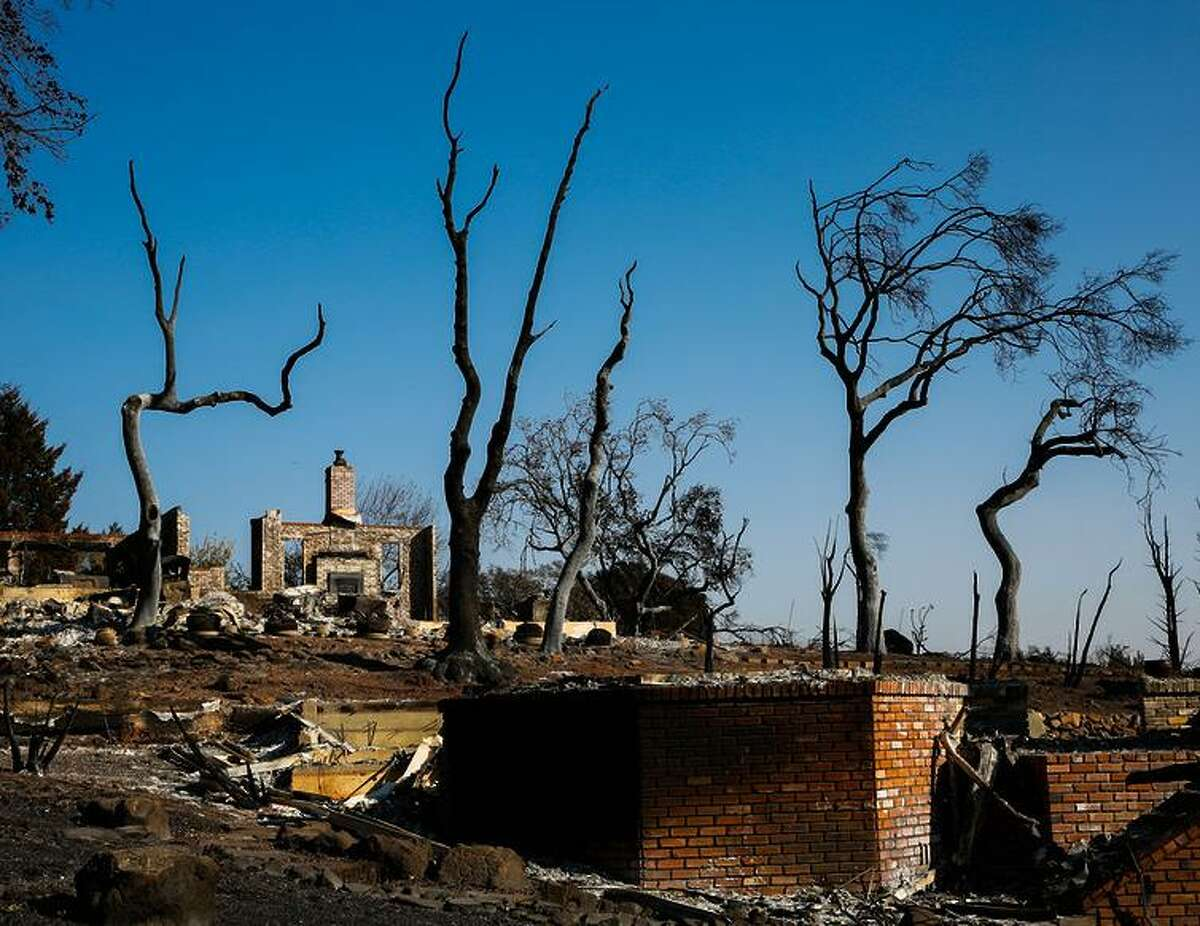 A chimney is all that remains after the Tubbs Fire ravaged the Fountaingrove neighborhood in Santa Rosa. The fire was 98 percent contained Sunday.